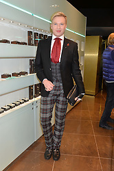 HENRY CONWAY at a party in celebration of LCM 2015 and the launch of the Tateossian's first ever men's-only boutique at 55 Sloane Square, London on 10th January 2015.