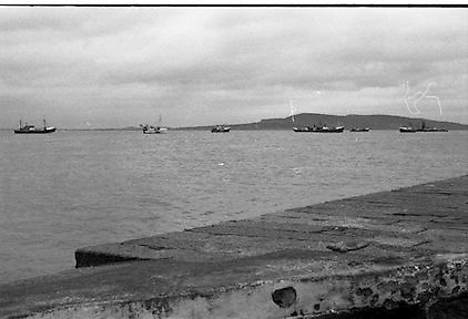 Blockade, Dublin Port by Fishing Trawlers.1982.22.10.1982.10.22.1982.22nd October 1982.As a result of E.U Fisheries policy, in regard to a total ban on herring fishing in the Irish Sea,blockades of eastern fishing ports were started. Several fishermen were imprisioned as a result..pictures  of ireland.pictures.Photos of Ireland.Photos .old pictures.old photos  of ireland.old photos.old photographs  of ireland.old photographs. images of Ireland.images.historic images  of ireland.historic images.Black and White images of Ireland.