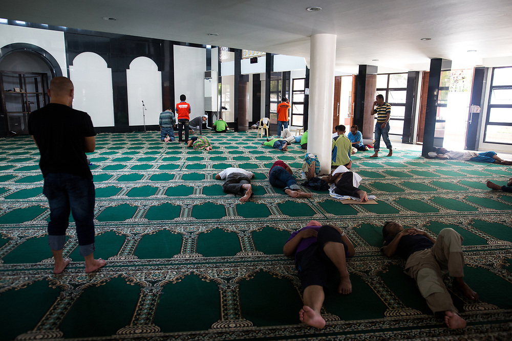 MARAWI, PHILIPPINES - JUNE 4: Muslim residents pray inside of a mosque in Marawi City in southern Philippines, June 4, 2017. Philippine Arm Forces and Marines continue to advance their positions as more soldiers reinforce to fight the Maute group in Marawi City, Mindanao, Philippines. (Photo: Richard Atrero de Guzman/ANADOLU Agency)