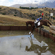 Emily Roche riding Southwind Summer Cascade in action at the water jump during the Cross Country event at the Wakatipu One Day Horse Trials at the Pony Club grounds,  Queenstown, Otago, New Zealand. 15th January 2012. Photo Tim Clayton