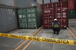 60144144  <br /> An investigation officer inspects a container with military equipments aboard the Chong Chon Gang vessel from the Democratic People s Republic of Korea (DPRK), at the Manzanillo International container terminal on the coast of Colon City, Panama, July 17, 2013. The Democratic People s Republic of Korea (DPRK) on Thursday demanded the release of a vessel seized in Panama suspected of carrying narcotic drugs and banned arms, claiming the weapons were being transported under a legitimate contract with Cuba, the official KCNA news agency reported,<br /> Wednesday, 17th July 2013<br /> Picture by imago / i-Images<br /> UK ONLY