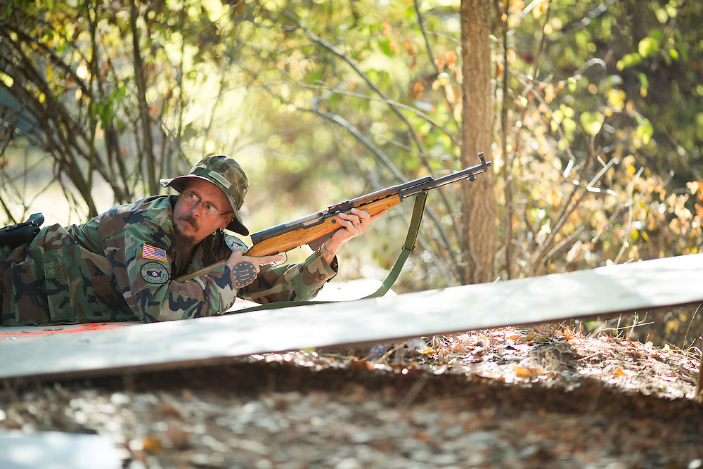 "Militia members from the several states, all of whom identify as part of the III% movement, gather near Jackson, Ga. on Saturday, Oct. 29, 2016 for training exercises. Here, Donald Ensey, who goes by ""Jest71"", a lieutenant in Florida Security Force III%, participates in target practice. Photo by Kevin D. Liles for The New York Times"