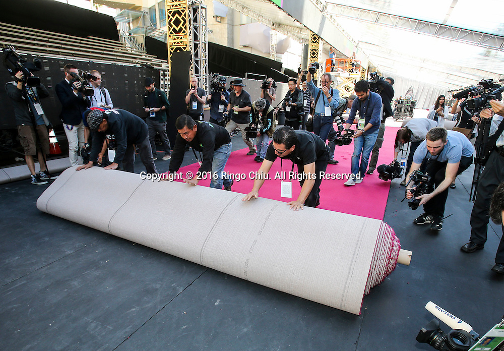 Workers roll out the red carpet for the Oscars in front of the Dolby Theatre in Los Angeles, Wednesday, February 24, 2016. The 88th Academy Awards will be held Sunday, February 28, 2016. (Photo by Ringo Chiu/PHOTOFORMULA.com)<br /> <br /> Usage Notes: This content is intended for editorial use only. For other uses, additional clearances may be required.