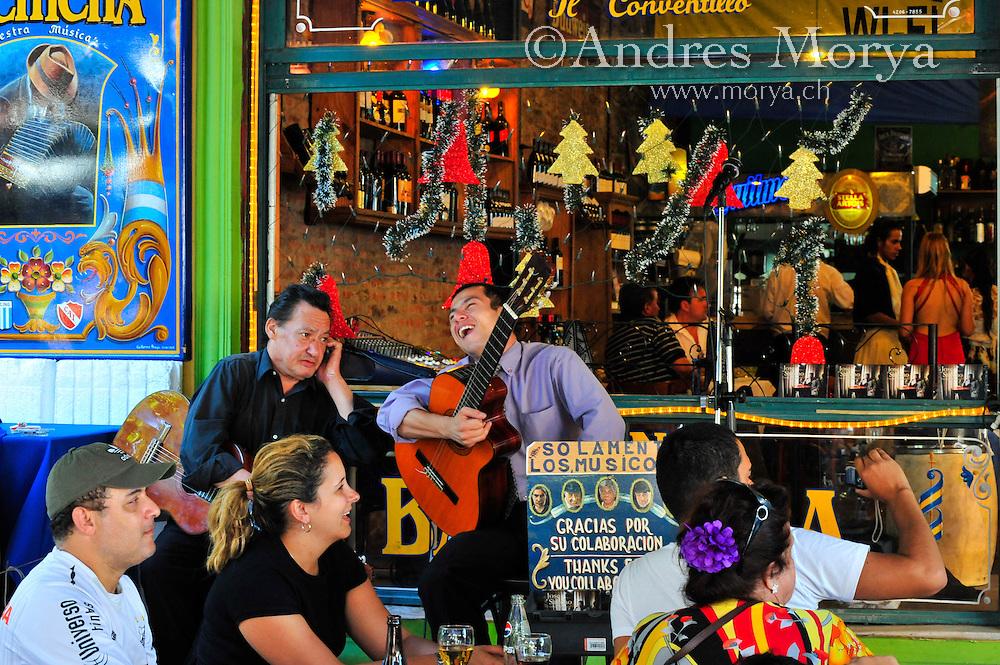 Tango musicians at Caminito , La Boca , Buenos Aires , Argentina Image by Andres Morya