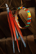Huaorani Indian feather crown. Gabaro Community. Yasuni National Park. Amazon rainforest, ECUADOR.  South America<br /> First a basket-like weave fibre ring is made. Then feathers collected from hunted toucans, parrots, macaws and other colourful birds are stuck on with heated beeswax. Macaw tail feathers - standing up are sometimes added later.<br /> This Indian tribe were basically uncontacted until 1956 when missionaries from the Summer Institute of Linguistics made contact with them. However there are still some groups from the tribe that remain uncontacted.  They are known as the Tagaeri. Traditionally these Indians were very hostile and killed many people who tried to enter into their territory. Their territory is in the Yasuni National Park which is now also being exploited for oil.