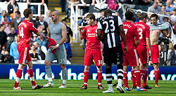NEWCASTLE-UPON-TYNE, ENGLAND - Sunday, April 1, 2012: Liverpool's Jose Enrique takes the goalkeepr shirt from goalkeeper Jose Reina after the 'keeper was sent off against Newcastle United during the Premiership match at St James' Park. (Pic by Vegard Grott/Propaganda)