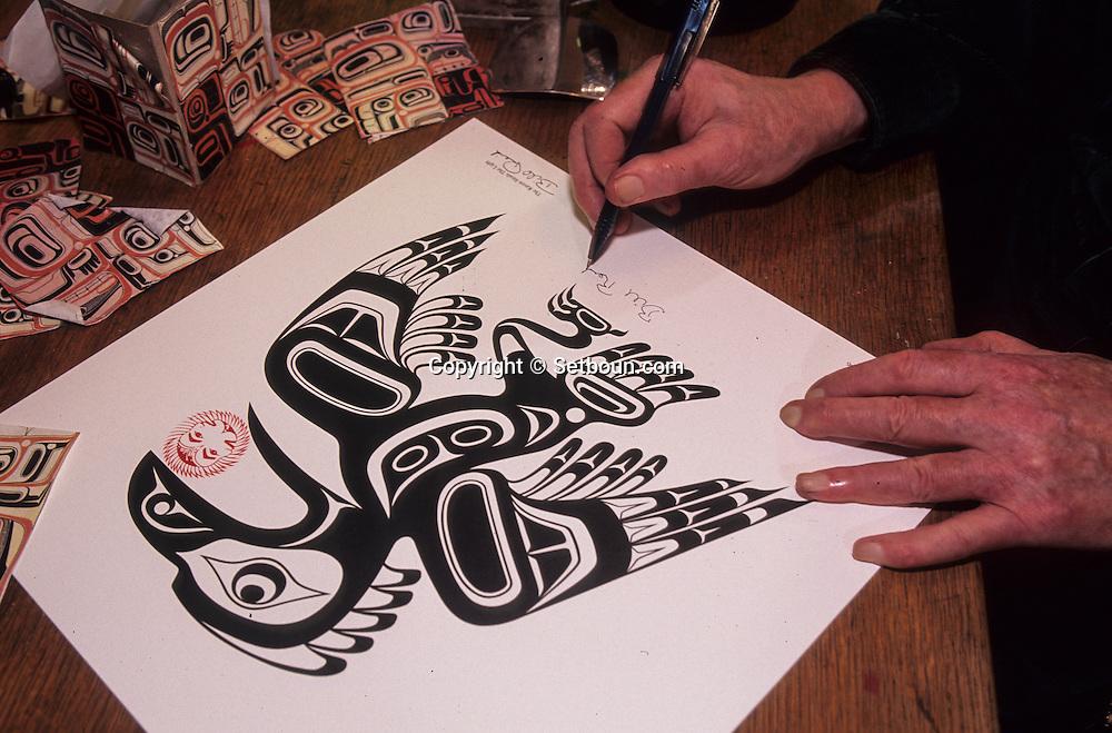 Canada. Vancouver     Bill Reid  - Haida -  Indian artist in his house in   /  Bill Reid, artiste indien de la tribu  - Haida -  chez lui à Vancouver.    Canada   /  Bill Reid à sa table de travail dans son atelier à Vancouver. Il signe les nombreuses estampes qui seront distribuées au cours du potlatch donné par le chef de son clan à Skidegate.