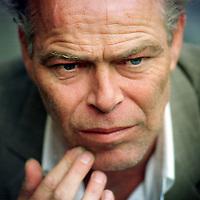 Nederland. Amsterdam. 27 mei 2003.<br /> Martin Bril voor de klapstoel, schrijver, columnist.