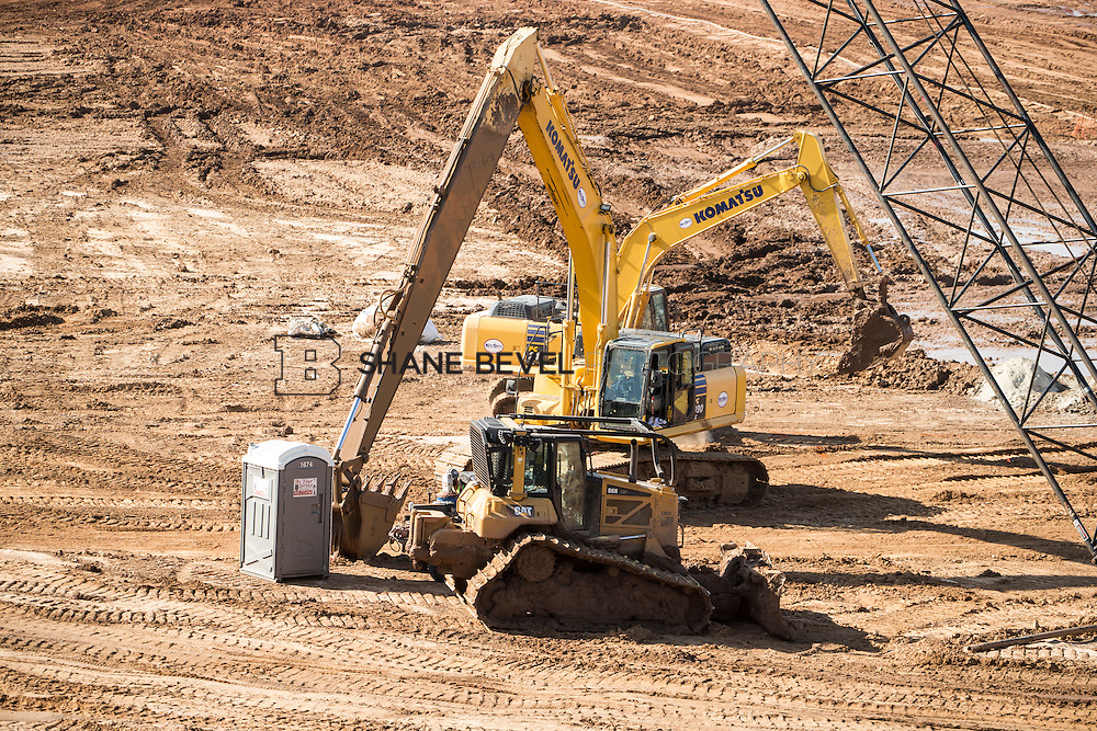 7/13/15 9:18:45 AM -- Major dirt work begins at A Gathering Place for Tulsa. Crews work on storm drainage, the slurry wall and digging the pond. <br /> <br /> Photo by Shane Bevel