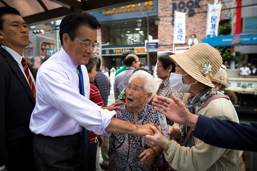 TOKYO, JAPAN - JULY 6 : Katsuya Okada President of Democratic Party of Japan (DPJ) shakes hands with the supporters during the Upper House election campaign outside of Machiya Station, Tokyo prefecture, Japan, on July 6, 2016. (Photo by Richard Atrero de Guzman/NUR Photo)