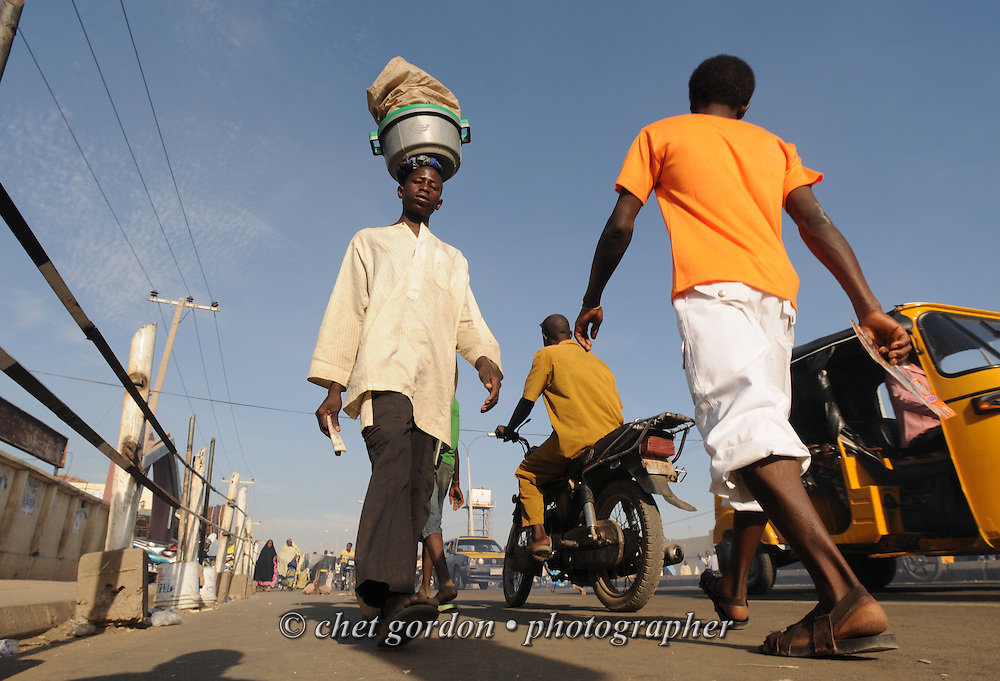 Pedestrians and street vendors move along a busy street in Kano, Nigeria on Wednesday afternoon, December 5, 2012.