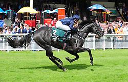 Caravaggio and Seamus Heffernan win the Keeneland Phoenix Stakes at Curragh Racecourse, Co. Kildare, Ireland.