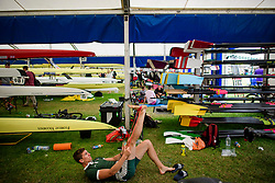 © Licensed to London News Pictures. 28/06/2017. London, UK. A rower stretches ahead of a race on day one of the Henley Royal Regatta, set on the River Thames by the town of Henley-on-Thames in England.  Established in 1839, the five day international rowing event, raced over a course of 2,112 meters (1 mile 550 yards), is considered an important part of the English social season. Photo credit: Ben Cawthra/LNP