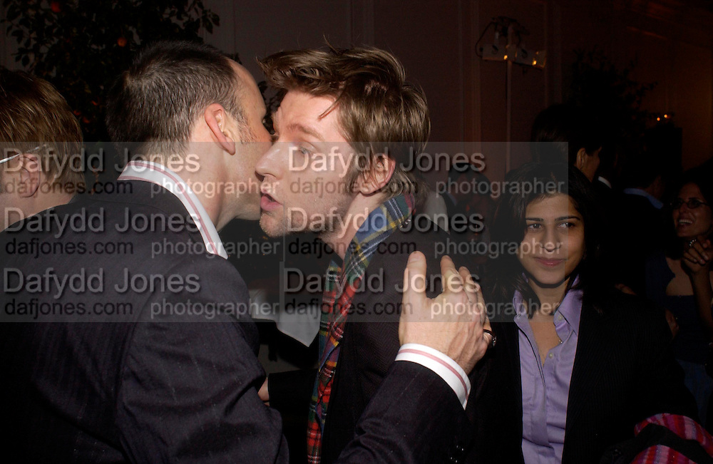 David Furnish and Christopher Bailey. Mario Testino, Bianca Jagger and Kenneth Cole celebrate Women to Women: Positively Speaking. - A publication to raise awareness of women living with Aids. The Orangery, Kensington Palace. 2 December 2004. ONE TIME USE ONLY - DO NOT ARCHIVE  © Copyright Photograph by Dafydd Jones 66 Stockwell Park Rd. London SW9 0DA Tel 020 7733 0108 www.dafjones.com