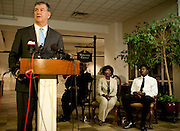 Karsiah Duncan, the son of Ebola patient Thomas Eric Duncan, looks on while Dallas Mayor Mike Rawlings speaks during a press conference at at Wilshire Baptist Church on October 7, 2014, in Dallas. (Cooper Neill for The New York Times)