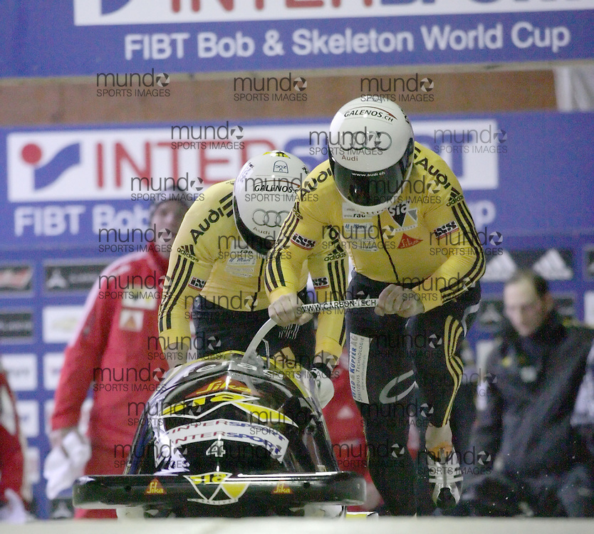 (November 21, 2009)Ivo Rueegg (front) and Roman Handschin of Swizterland push the Swiss 1 sled the start of the first two-man bobsleigh run. They finished third at the Federation Internationale de Bobsleigh et de Togogganing (FIBT) two-man men's bobsled World Cup race at the Olympic Sports Complex in Lake Placid, New York.
