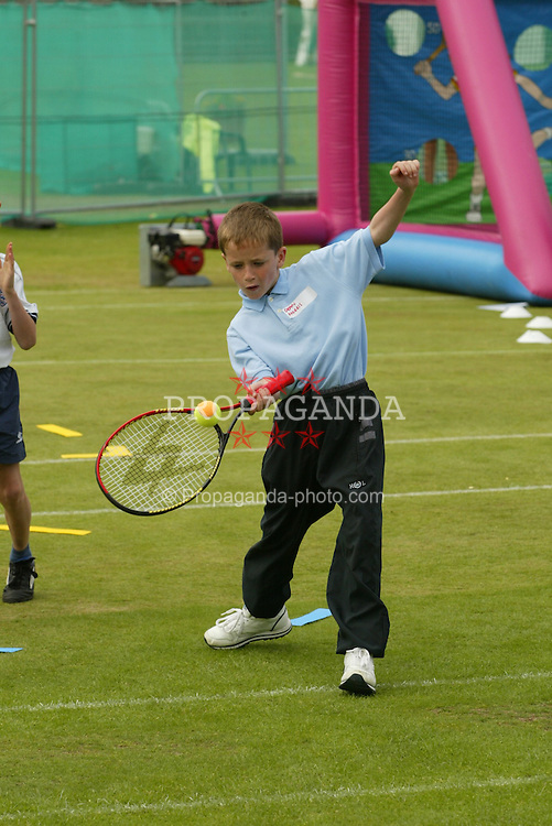 LIVERPOOL, ENGLAND - Sunday, June 22, 2002: Kids have fun at the Liverpool International in Calderstones Park.