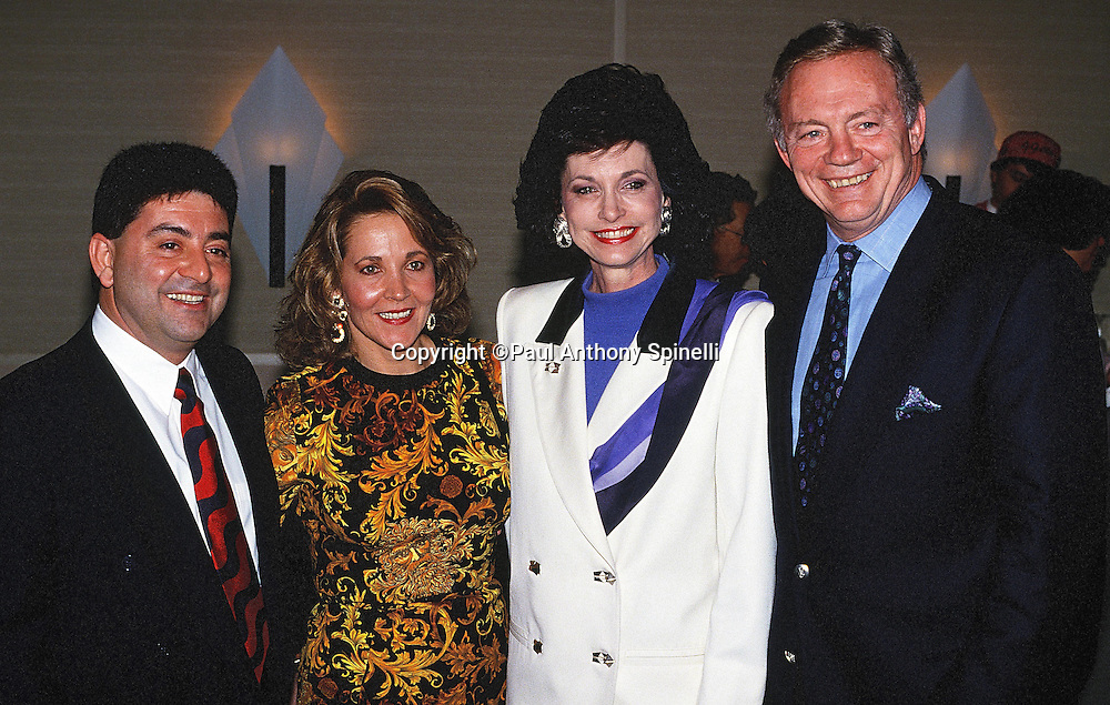 San Francisco 49ers owner Eddie DeBartolo Jr. (left) poses for a photo with Dallas Cowboys owner Jerry Jones (right) and spouses at an NFL party the night before the San Francisco 49ers NFL NFC Championship playoff football game against the Dallas Cowboys on Jan. 16, 1993 in San Francisco. The Cowboys won the game 30-20. (©Paul Anthony Spinelli)