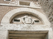 Decorative detail from the area surrounding Castel Sant'Angelo and the Ponte Sant'Angelo in Rome, Italy. Many decorative sculptural and architectural details adorn the length of the bridge, as well as the area surrounding it and the Castel Sant'Angelo. This image shows a decorative emblem.