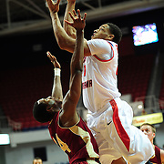 South Alabama's forward Augustine Rubit (21) shoots over Denver's forward, Chris Udofia (34),  in the first half of play in Mobile, AL. Denver leads South Alabama 30-24 at halftime on January 7, 2012...