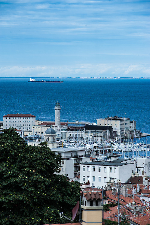 A view of the marina with the lighthouse seen from San Giusto in  Trieste, Italy.