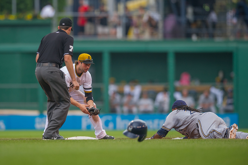 PITTSBURGH, PA - JUNE 08: Neil Walker #18 of the Pittsburgh Pirates awaits the throw as Rickie Weeks #23 of the Milwaukee Brewers slides into second base at PNC Park on June 8, 2014 in Pittsburgh, Pennsylvania. (Photo by Rob Tringali) *** Local Caption *** Neil Walker;Rickie Weeks
