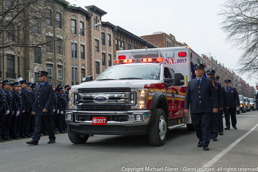 25 Mar 2017 Bronx, New York United States of America // Funeral Service for EMT Yadira Arroyo at FDNYEMS Station 26 at the Saint Nicholas of Tolentine R.C.  Bronx. EMT Arroyo, who lived in the Bronx, is survived by her five sons, Jose Montes, 23; Edgar Montes, 22; Kenneth Robles, 19; Justin Robles, 16; and Isaiah Negron, 7; her parents, mother Laida Acevedo-Rosado and father Luis Arroyo, Sr.; her siblings Joell Arroyo and Luis Arroyo, Jr.; and numerous other relatives, including her stepfather Efrain Rosado and nine aunts and uncles.  Michael Glenn / Glenn Images