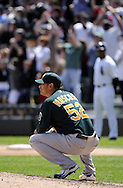 CHICAGO - JUNE 12:  Guillermo Moscoso #52 of the Oakland Athletics reacts after giving up a three-run home run by Adam Dunn #32 of the Chicago White Sox in the fourth inning on June 12, 2011 at U.S. Cellular Field in Chicago, Illinois.  The White Sox defeated the Athletics 5-4.  (Photo by Ron Vesely)   Subject:  Adam Dunn;Guillermo Moscoso