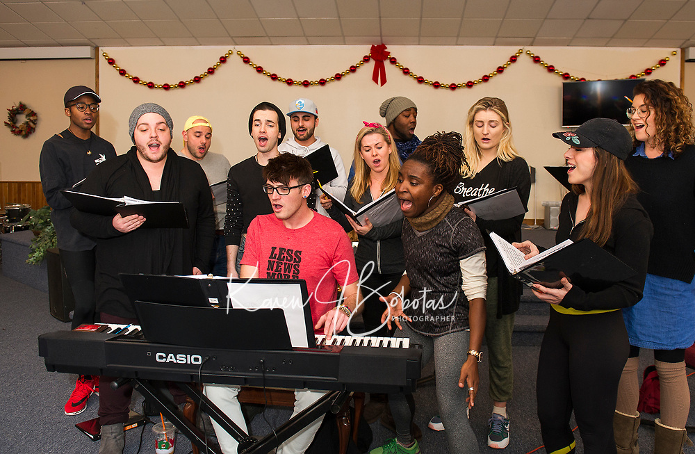 """Patrick Dorow on keyboard works through a practice session with his cast for the Christmas music extravaganza """"Home for the Holidays"""" to be presented by Interlakes Theater at the Flying Monkey on December 15th-16th. (l-r) back row Dwight Robinette, Mikey LoBalsamo, Giovanni Beatty and LaRon Hudson middle row Sam St. Jean, Brandon Omega, Chelsea Hermann, Merrill Peiffer and Rachel Pantazis  front row Patrick Dorow, Brittney Mack and Julia Suriano.     (Karen Bobotas/for the Laconia Daily Sun)"""