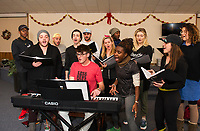 "Patrick Dorow on keyboard works through a practice session with his cast for the Christmas music extravaganza ""Home for the Holidays"" to be presented by Interlakes Theater at the Flying Monkey on December 15th-16th. (l-r) back row Dwight Robinette, Mikey LoBalsamo, Giovanni Beatty and LaRon Hudson middle row Sam St. Jean, Brandon Omega, Chelsea Hermann, Merrill Peiffer and Rachel Pantazis  front row Patrick Dorow, Brittney Mack and Julia Suriano.     (Karen Bobotas/for the Laconia Daily Sun)"