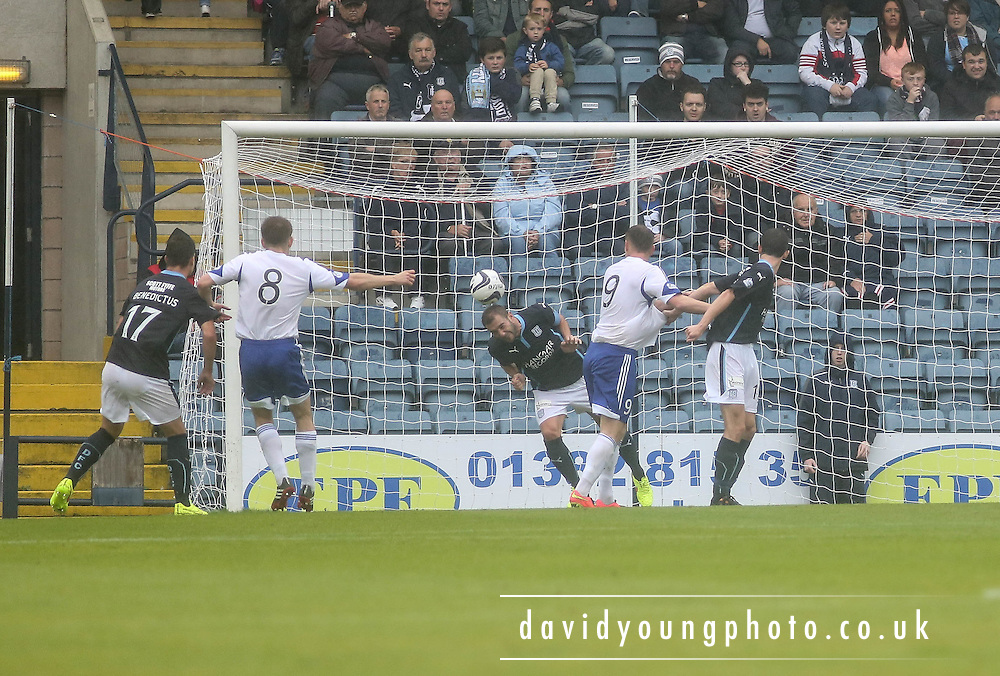 Dundee's Kevin Thomson heads Peterhead's Ross Smith's goal bound effort of the line - Dundee v Peterhead, League Cup at Dens Park<br /> <br />  - &copy; David Young - www.davidyoungphoto.co.uk - email: davidyoungphoto@gmail.com