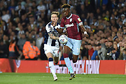 West Bromwich Albion midfielder (on loan from Fulham) Stefan Johansen (6) battles for possession  withAston Villa striker(on loan from Chelsea) Tammy Abraham (18) during the EFL Sky Bet Championship play-off second leg match between West Bromwich Albion and Aston Villa at The Hawthorns, West Bromwich, England on 14 May 2019.