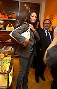 Trisha Simonon and Diego Della Valle.  Tod's hosts Book signing with Dante Ferretti celebrating the launch of 'Ferretti,- The art of production design' by Dante Ferretti. tod's, Old Bond St. 19 April 2005.  ONE TIME USE ONLY - DO NOT ARCHIVE  © Copyright Photograph by Dafydd Jones 66 Stockwell Park Rd. London SW9 0DA Tel 020 7733 0108 www.dafjones.com