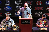 LAS VEGAS, NEVADA, JULY 9, 2009: UFC president Dana White (centre) is flanked by heavyweight title contenders Brock Lesnar (left) and Frank Mir (right) during the pre-fight press conference for UFC 100 inside the House of Blues in Las Vegas, Nevada