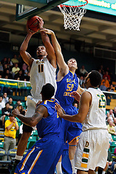Nov 16, 2011; San Francisco CA, USA;  San Francisco Dons center Justin Raffington (11) is fouled by San Jose State Spartans forward Garrett Ton (50) while shooting during the first half at War Memorial Gym.  Mandatory Credit: Jason O. Watson-US PRESSWIRE