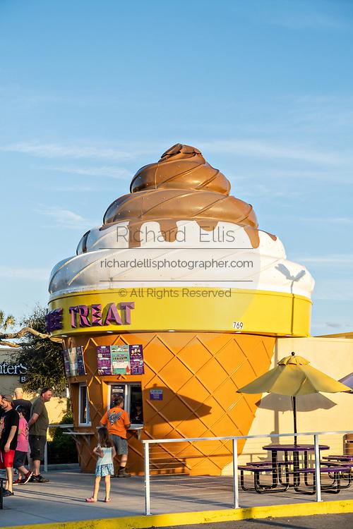 A soft serve ice cream shop, shaped like a giant cone in New Smyrna Beach, Florida.