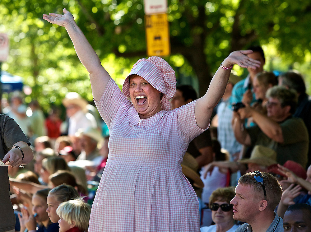 Nancy Bittner of Centerville, Utah waves to the parade participants as she and other spectators watch the floats, horses and celebrities participate in the Days of '47 Parade in Salt Lake City, Utah, Saturday, July 24, 2010. August Miller, Deseret News .