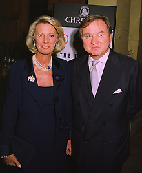 SIR ANTHONY & LADY BAMFORD at a reception in London on 5th November 1997.MCZ 27
