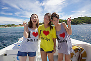 Pattaya Beach. Tourists from Japan leaving on the ferry to Langkawi show their affection for the island.