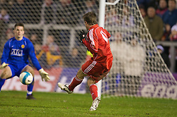 WARRINGTON, ENGLAND - Tuesday, February 26, 2008: Liverpool's Harry Kewell scores the second goal past Manchester United's goalkeeper Tom Heaton during the FA Premiership Reserves League (Northern Division) match at the Halliwell Jones Stadium. (Photo by David Rawcliffe/Propaganda)