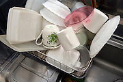 dishes drying in dish rack on countertop