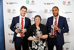 CARDIFF, WALES - Monday, October 6, 2014: Wales' Young Player of the Year Ben Davies, FAW Service award winner Swansea City Ladies' Julie Lowe and Club Player of the Year captain Ashley Williams at the FAW Footballer of the Year Awards 2014 held at the St. David's Hotel. (Pic by David Rawcliffe/Propaganda)