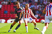 Leeds United midfielder Kalvin Phillips (23) and Stoke City midfielder Mark Duffy (31) during the EFL Sky Bet Championship match between Stoke City and Leeds United at the Bet365 Stadium, Stoke-on-Trent, England on 24 August 2019.