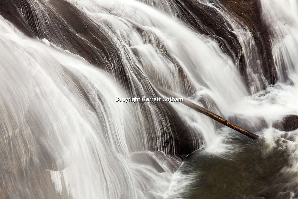 Water flows through Firehole Falls in Yellowstone National Park.