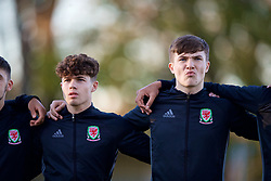 BANGOR, WALES - Saturday, November 17, 2018: Wales' Neco Williams (L) and Morgan Boyes stand for the national anthem before the UEFA Under-19 Championship 2019 Qualifying Group 4 match between Sweden and Wales at the Nantporth Stadium. (Pic by Paul Greenwood/Propaganda)