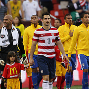 Carlos Bocanegra, USA, leads his team out before the USA V Brazil International friendly soccer match at FedEx Field, Washington DC, USA. 30th May 2012. Photo Tim Clayton