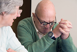 A man and woman sitting and talking at the Nottingham Royal Society for the Blind (NRSB),