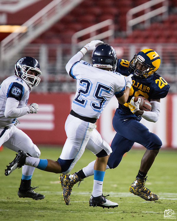 Milpitas running back Tariq Bracy, 20, carries the ball against Valley Christian's Isaiah Rodriguez, 25, during Friday Night Lights at Levi's Stadium in Santa Clara, California, on September 18, 2015.  Milpitas went on to lose 22-21 against Valley Christian.  (Stan Olszewski/SOSKIphoto)