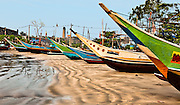 These colorful boats go out at night and return early in the morning with their catches.<br /> (Photo by Matt Considine - Images of Asia Collection)