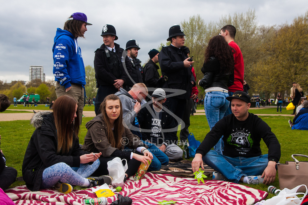 Hyde Park, London, April 19th 2015. Hundreds of cannabis users and their supporters gather at Speaker's Corner in Hyde Park for the annual London 420 pro-cannabis rally, under the watcful eye of Metropolitan Police officers, who kept a reasonably low profile, allowing the rally to continue without any serious incidents.